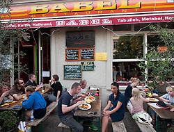 Busy Lebanese restaurant with pavement seating on bohemian Kastanienallee in Prenzlauer Berg in berlin Germany