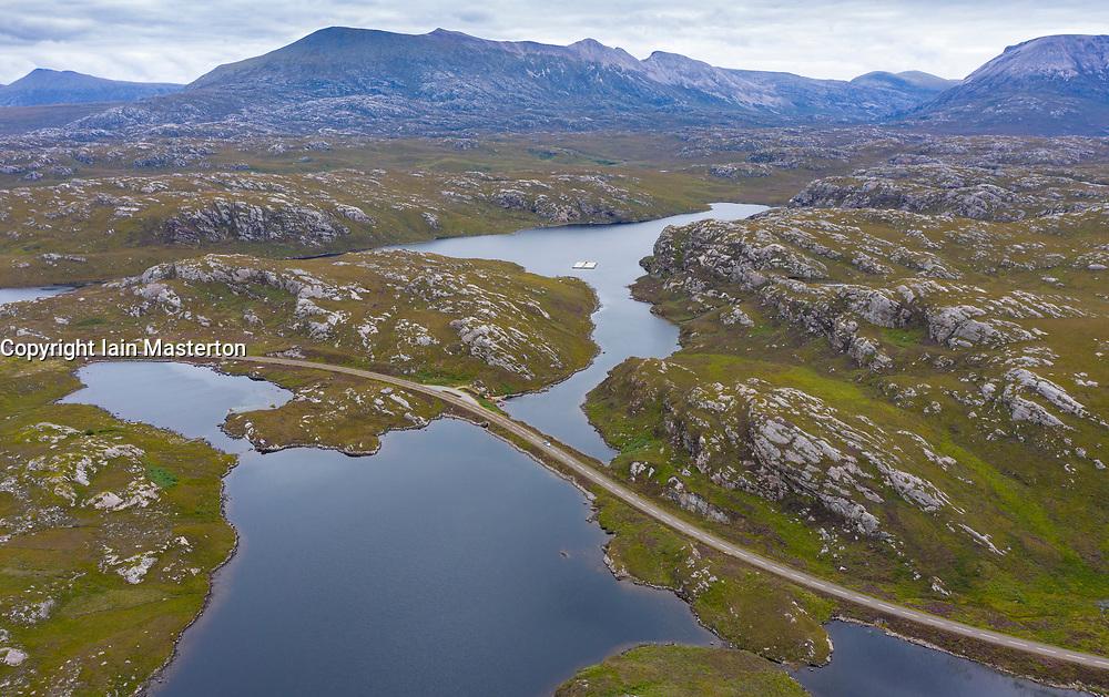 Aerial view of highway part of North Coast 500 tourist route north of  Kylesku in Sutherland, Highland Region, Scotland UK