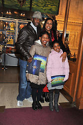 Actor ADRIAN LESTER, his wife LOLITA and their daughters LILA & JASMINE attend the premier of 2012 Cirque du Soleil's Totem at the Royal Albert Hall, London on 5th January 2012,