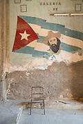 Mural with Cuban flag and Camilo Cienfuegos on Paladar La Guarida restaurant wall, Havana, Cuba