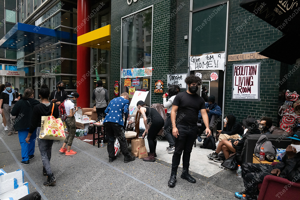 NEW YORK, NEW YORK: Members of Abolition park stage a sit in on the sidewalk at Governor Cuomo's New York City office in New York, New York on Tuesday, September 29, 2020. .  The demonstrators are protesting for rent cancellation during the current pandemic. The protests has been ongoing for the last 24 hours.  (©Brian Branch-Price/TheFotodesk)