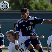 Fullerton's forward, Eduin Munguia, coimpetes with Golden West's defender, Calvin Cruz compete for the ball during Friday evening's match. Fullerton beat Golden West 2-0 in a dramatic game.