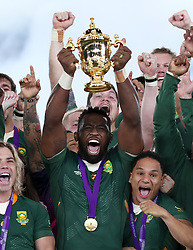 South Africa's Siya Kolisi lifts the trophy as South Africa win the 2019 Rugby World Cup final match at Yokohama Stadium.