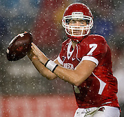 Oct 27, 2011; Houston, TX, USA; Houston Cougars quarterback Case Keenum (7) passes against the Rice Owls during the first half at Robertson Stadium. Mandatory Credit: Thomas Campbell