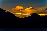 Winter landscape near Tranoyalong the coastline between  Harstad and Finnsnes, Arctic, Northern Norway just before sunrise.