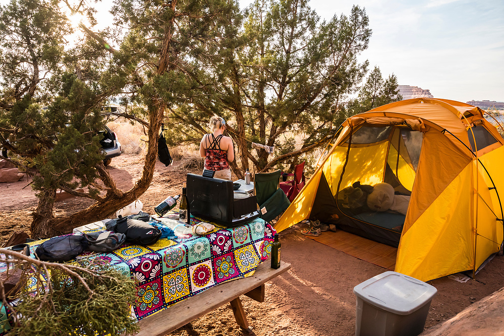 A woman in her campsite at Needles Outpost just outside the National Park boundary of Canyonlands National Park, Utah, USA.