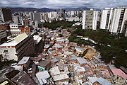 High-rise skyline of Caracas, Venezuela, with poor neighborhood in the foreground.