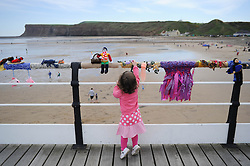 © Licensed to London News Pictures. 27/05/2013..Saltburn, England..Megan Wright, 2, from Plymouth enjoys the display as once again the mysterious group of knitters in Saltburn by the Sea in Cleveland have been working their magic and have produced another amazing display of local seaside scenes created out of wool and attached to the Victorian Pier in the town...The woollen figures first appeared last year to mark the Olympics and then the royal wedding and created a storm of interest in the figures and brought many visitors into the town...Photo credit : Ian Forsyth/LNP