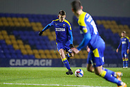 w42\ shootsa at goal during the EFL Trophy match between AFC Wimbledon and U21 Arsenal at Plough Lane, London, United Kingdom on 8 December 2020.