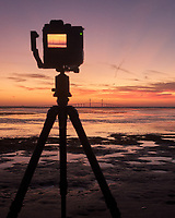 Fuji X-H1 camera set up to record the sun rising under the Sunshine Skyway bridge from Fort De Soto park in St. Petersburg, Florida. Image taken with a Leica CL camera and 23 mm f/2 lens (ISO 1000, 23 mm, f/5.6, 1/60 sec).