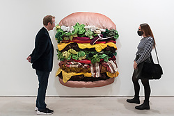 """© Licensed to London News Pictures. 21/10/2020. LONDON, UK. """"Bon Appetit"""", 2019, by Korean artist Eunha Kim, a collage made from abandoned clothes. Preview of STARTnet Art Fair at the Saatchi Gallery in Chelsea.  The contemporary art fair showcases local London, as well as international, galleries and individual artists from all over the world.  The fair runs 21 to 25 October with Covid-19 protocols in place for visitors.   Photo credit: Stephen Chung/LNP"""