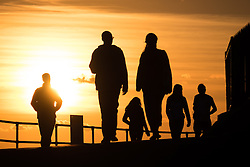 © Licensed to London News Pictures. 02/10/2016. Southsea, Hampshire, UK.  People out and about enjoying the last of the evening light on what has been another warm and sunny autumn day in the South of England. Photo credit: Rob Arnold/LNP