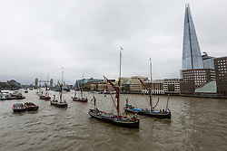 © Licensed to London News Pictures. 17/09/2016. LONDON, UK.  Sailing barges parade on the River Thames, passing under Tower Bridge in London for the first ever Thames Sailing Barge Parade. The event aims to recreate scenes from Londonís days as a bustling trading port and the historic sailing barges taking part have not been seen together in one place since the industrial revolution.  Photo credit: Vickie Flores/LNP