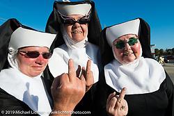 My three nuns on the final Saturday on Main Street during Daytona Bike Week. FL, USA. March 15, 2014.  Photography ©2014 Michael Lichter.