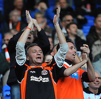 Blackpool fans cheer on their side during today's match<br /> <br /> Photographer Kevin Barnes/CameraSport<br /> <br /> Football - The Football League Sky Bet Championship - Reading v Blackpool - Saturday 25th October 2014 - Madejski Stadium - Reading <br /> <br /> © CameraSport - 43 Linden Ave. Countesthorpe. Leicester. England. LE8 5PG - Tel: +44 (0) 116 277 4147 - admin@camerasport.com - www.camerasport.com