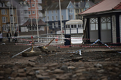 © London News Pictures. 05/01/2014. Aberystwyth, UK.  Damage caused to Aberystwyth promenade which is littered with debris following days of high tides and storms. Much of the seafront has been severely damaged by the pounding pif the waves, with the likely cost of repairs running into the millions of pounds. Photo credit Keith Morris: LNP