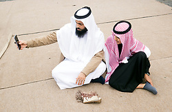 Amin Alzahrani with his son Anas Alzahrani, takes a photograh following the Eid prayer, which marks the end of Ramadan and the start of Eid, at Leeds Grand Mosque in Yorkshire.