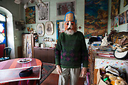 Avrham Yachin, an artist, is wearing a mask he made in his home in Jerusalem.