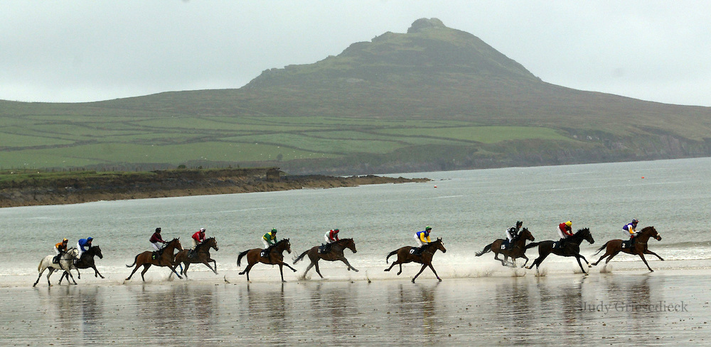 In a race against time, jockeys race horses along the beach as the tide comes in during a festival in Dingle, Ireland.