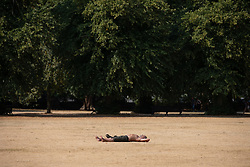 July 27, 2018 - London, UK. People enjoy the hot weather in Greenwich Park. Temperatures in the capital reached over 30 degrees yesterday, as the UK experiences a prolonged heatwave. Thunder and lightning is forecast later today. (Credit Image: © Tom Nicholson/London News Pictures via ZUMA Wire)