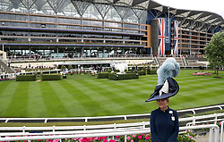 A racegoer by the parade ring during day one of Royal Ascot at Ascot Racecourse.