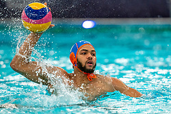Bilal Gbadamassi of the Netherlands in action against Croatia during the Olympic qualifying tournament. The Dutch water polo players are on the hunt for a starting ticket for the Olympic Games on February 15, 2021 in Rotterdam
