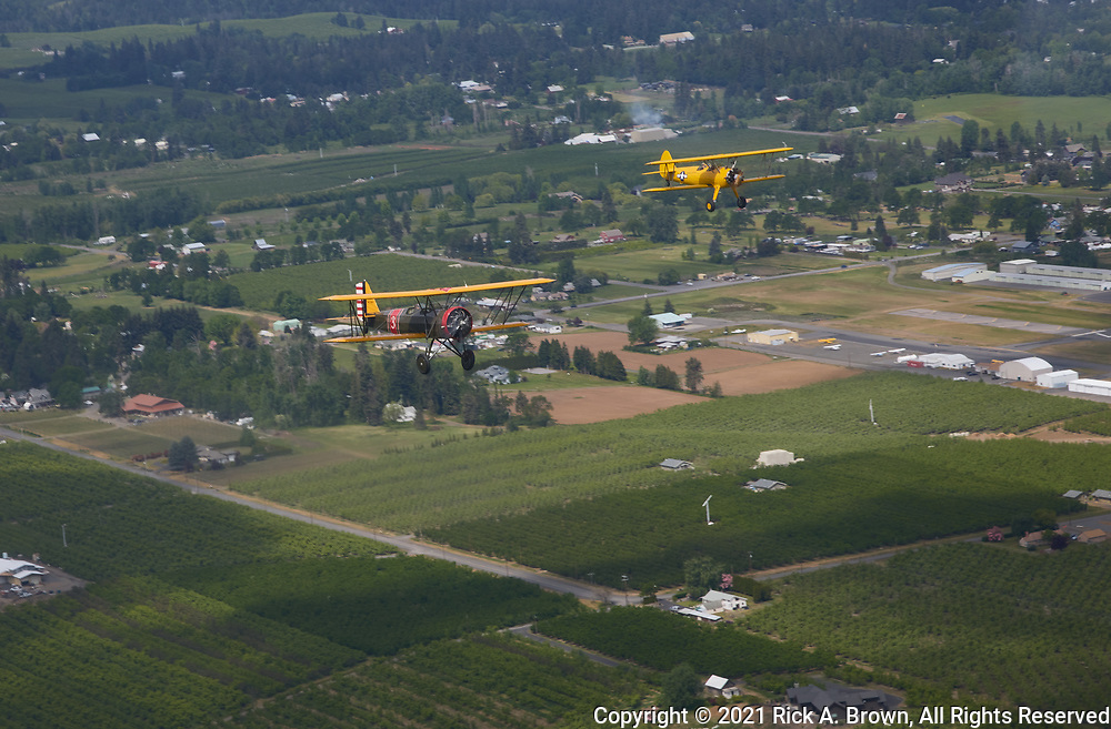 Stearman N2S-3 and Cloudboy in formation over the Hood River Valley.