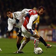 Arsenal's Freddie Ljungberg tangles with Valencia's Vincente