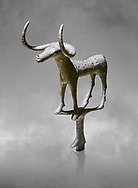 Bronze Age Hattian ceremonial bull statuette in bronze from a possible Bronze Age Royal grave (2500 BC to 2250 BC) - Alacahoyuk - Museum of Anatolian Civilisations, Ankara, Turkey .<br /> <br /> If you prefer to buy from our ALAMY PHOTO LIBRARY  Collection visit : https://www.alamy.com/portfolio/paul-williams-funkystock/royal-tombs-alaca-hoyuk-bronze-age.html (TIP refine search by adding background colour in the LOWER search box)<br /> <br /> Visit our ANCIENT WORLD PHOTO COLLECTIONS for more photos to download or buy as wall art prints https://funkystock.photoshelter.com/gallery-collection/Ancient-World-Art-Antiquities-Historic-Sites-Pictures-Images-of/C00006u26yqSkDOM