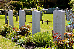 Deserted churchyard of The Priory church of Lady St Mary where the tomb stones of German servicemen killed in WW2 lie buried. VE Day May 2020 Wareham Dorset UK