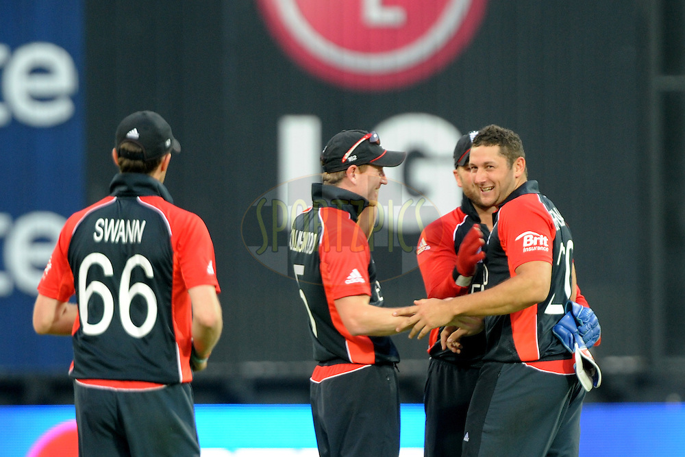 Tim Bresnan of England is congrajulated by teammates after taking a wicket during the ICC Cricket World Cup match between India and England held at the M Chinnaswamy Stadium in Bengaluru, Bangalore, Karnataka, India on the 27th February 2011..Photo by Pal Pillai/BCCI/SPORTZPICS