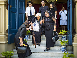 October 14, 2016 - Bangkok, Bangkok, Thailand - Mourners leave the Sahathai Samakom Pavilion at the Grand Palace in Bangkok after paying respects to Bhumibol Adulyadej, the King of Thailand, who died Oct. 13, 2016. He was 88. His death comes after a period of failing health. With the king's death, the world's longest-reigning monarch is Queen Elizabeth II, who ascended to the British throne in 1952. Bhumibol Adulyadej, was born in Cambridge, MA, on 5 December 1927. He was the ninth monarch of Thailand from the Chakri Dynasty and is known as Rama IX. He became King on June 9, 1946 and served as King of Thailand for 70 years, 126 days. He was, at the time of his death, the world's longest-serving head of state and the longest-reigning monarch in Thai history. (Credit Image: © Jack Kurtz via ZUMA Wire)