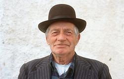 Portrait of elderly man wearing hat,