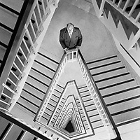 Portrait of businessman in staircase