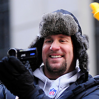 Pittsburgh Steelers quarterback Ben Roethlisberger  videos the fans along the route the victory parade for the winners of Super Bowl XLIII in Pittsburgh, on February 3, 2009.  The Steelers defeated the Arizona Cardinals  in Super Bowl XLIII 27-23.       (UPI Photo/Archie Carpenter)