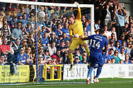 Portsmouth goalkeeper Craig MacGillivray (15) hanging onto cross bar during the EFL Sky Bet League 1 match between AFC Wimbledon and Portsmouth at the Cherry Red Records Stadium, Kingston, England on 13 October 2018.