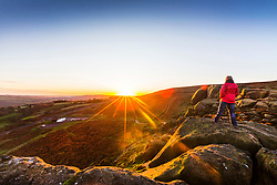 © Licensed to London News Pictures. 12/11/2017. Ilkley UK. This mornings sunrise is seen from the top of Ilkley Moor in Yorkshire on Remembrance Sunday. Photo credit: Andrew McCaren/LNP