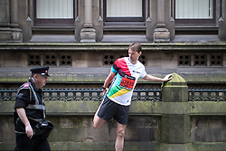 © Licensed to London News Pictures . 28/05/2017 . Manchester , UK . People warm up outside Manchester Town Hall . The Great Manchester Run 2017 . Security is still heightened in Manchester following a murderous bomb attack at an Ariana Grande gig at Manchester Arena on Monday 22nd May . Photo credit : Joel Goodman/LNP