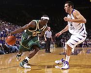 Cleveland State forward Patrick Tatham (21) drives against pressure form Kansas State Center Jason Bennett (55) in the first half at Bramlage Coliseum in Manhattan, Kansas, December 5, 2006.  K-State beat the Vikings 93-60.<br />