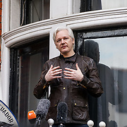 Julian Assange speaks at the Ecuador embassy