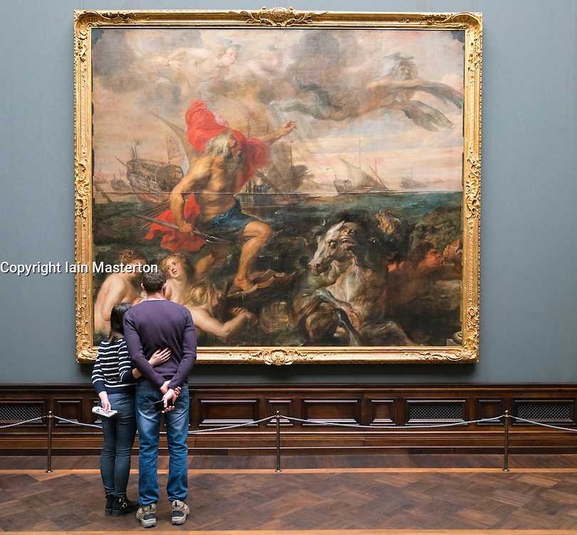 "Visitors looking at painting "" Neptune Calming the Waves "" by Peter Paul Rubens at Gemäldegalerie Alte Meister or Zwinger Museum in Dresden, Germany .Editorial Use Only."