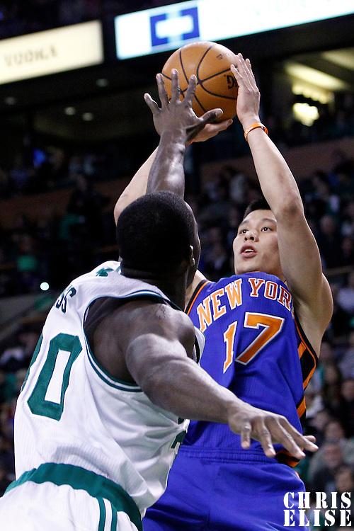 04 March 2012: New York Knicks point guard Jeremy Lin (17) takes a jumpshot over Boston Celtics power forward Brandon Bass (30) during the Boston Celtics 115-111 (OT) victory over the New York Knicks at the TD Garden, Boston, Massachusetts, USA.
