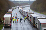 Drivers mingle out of their cabs as their freight Lorries line up in queues contained in operation Stack on the M20 motorway at Ashford, Kent, United Kingdom on the 23rd of December 2020. Truck drivers have been waiting in operation stack on the M20 motorway for over 48 hours now, France closed it's boarders with the UK after a new faster spreading strain of the COVID-19 virus broke out in Kent. (photo by Andrew Aitchison / In pictures via Getty Images)