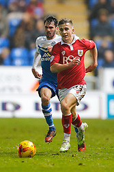 Joe Bryan of Bristol City is challenged by Michael Smith of Peterborough United - Photo mandatory by-line: Rogan Thomson/JMP - 07966 386802 - 28/11/2014 - SPORT - FOOTBALL - Peterborough, England - ABAX Stadium - Peterborough United v Bristol City - Sky Bet League 1.