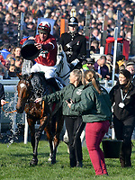 National Hunt Horse Racing - 2019 Randox Health Grand National Festival - Saturday, Day Three (Grand National Day)<br /> <br /> 1st placed D N Russell on 3 Tiger Roll dowses his horse with a bucket of water as he celebrates after winning the 17:15 Randox Health Grand National Handicap Chase (Grade 3, Class 1), at Aintree Racecourse.<br /> .<br /> <br /> COLORSPORT/WINSTON BYNORTH