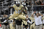 Central Florida defensive end Troy Davis (58) celebrates with teammate E.J. Dunston (obscured) after Davis sacked UTEP quarterback Nick Lamaison during the first half of an NCAA college football game in Orlando, Fla., Friday, Nov. 25, 2011.(AP Photo/Phelan M. Ebenhack)