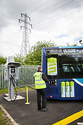 A Nottingham Community Transport bus driver unplugging in one of the Ecolink zero emissions buses to charge in Nottingham, Nottinghamshire, United Kingdom. <br /> (photo by Andrew Aitchison / In pictures via Getty Images)