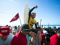 December 18, 2017 - Banzai Pipeline, HI, USA - BANZAI PIPELINE, HI - DECEMBER 18, 2017 - John John Florence of Hawaii is carried after winning his semifinal heat and winning the World Surf League World Title at the Billabong Pipe Masters. (Credit Image: © Erich Schlegel via ZUMA Wire)