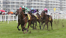 Mr Lupton and Gerald Mosse (green and white cap) win The Dubai International Airport World Trophy Stakes Race run during day two of Dubai Duty Free International Weekend at Newbury Racecourse.