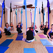 People participate in an Aerial Yoga class at Salty Dog Yoga Sunday April 6, 2014 in Carolina Beach, N.C. (Jason A. Frizzelle)